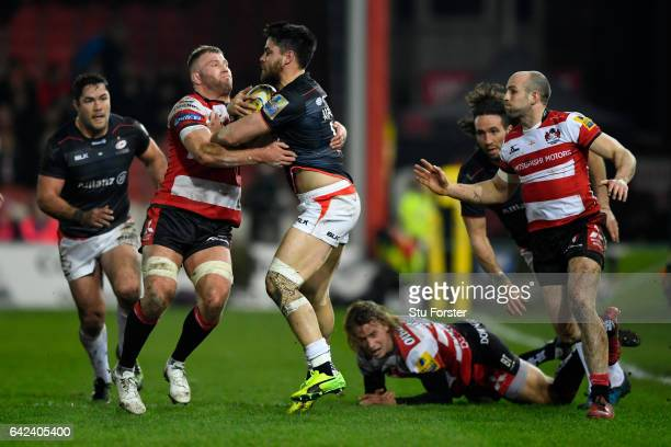 Saracens full back Sean Maitland runs into the tackle of Ross Moriarty during the Aviva Premiership match between Gloucester Rugby and Saracens at...