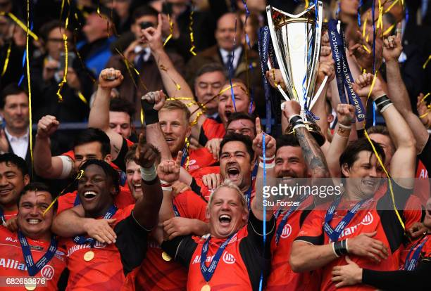 Saracens lift the trophy following their 2817 victory during the European Rugby Champions Cup Final between ASM Clermont Auvergne and Saracens at...