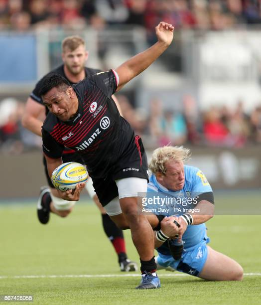 Saracens' Mako Vunipola breaks the tackle of London Irish's Petrus Du Plessis to score the first try during the Aviva Premiership match at Allianz...