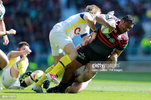 Saracens Mako Vunipola is tackled by Clermont's Gerhard Vosloo during the Heineken Cup Semi Final match at Twickenham London