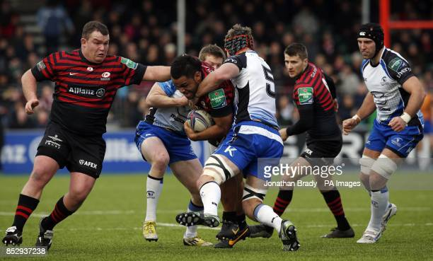 Saracens' Mako Vunipola is tackled by Connacht's Craig Clarke during the Heineken Cup Pool Three match at Barnet Copthall London