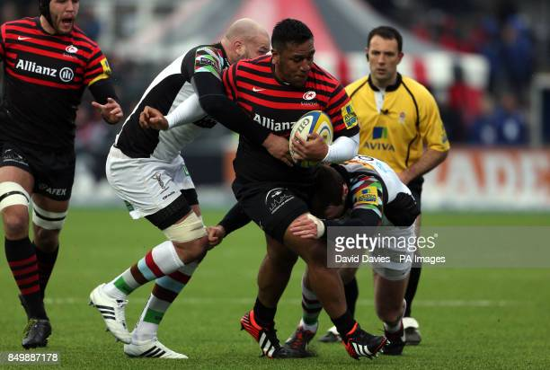 Saracens Mako Vunipola is tackled by Harlequins George Robson and Tom Guest during the Aviva Premiership match at Allianz Park London