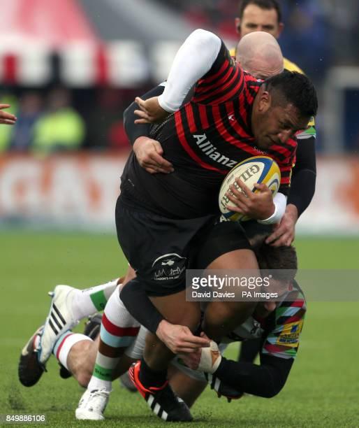Saracens Mako Vunipola is tackled by Harlequins Tom Guest during the Aviva Premiership match at Allianz Park London