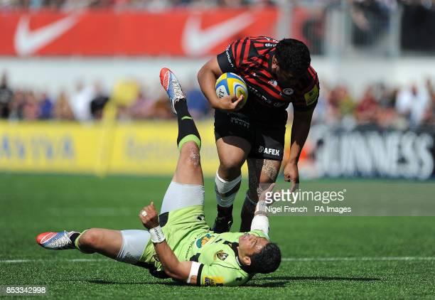 Saracen's Mako Vunipola is tackled by Northampton Saints George Pisi during the Aviva Premiership match at Allianz Park Hendon