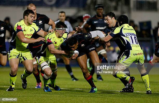 Saracens' Nathan Earle and Sale Sharks' AJ MacGinty and Sale Sharks' Tom Curry during the European Champions Cup Pool Three match at Allianz Park...