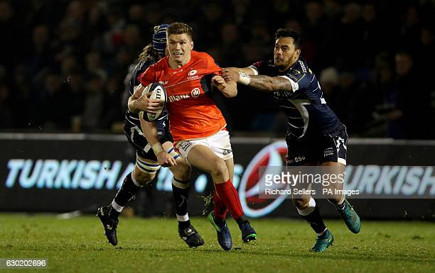 Saracens Owen Farrell breaks through as Sale Sharks Denny Solomona tackles during the European Champions Cup pool three mach at the AJ Bell Stadium...