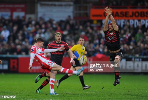 Saracens player Alistair Hargreaves attempts to block a Freddie Burns kick during the Aviva Premiership match between Gloucester and Saracens at...