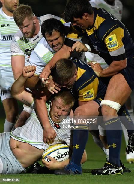 Saracens player Jackson Wray is stopped by the Warriors defence during the Aviva Premiership match between Worcester Warriors and Saracens at Sixways...