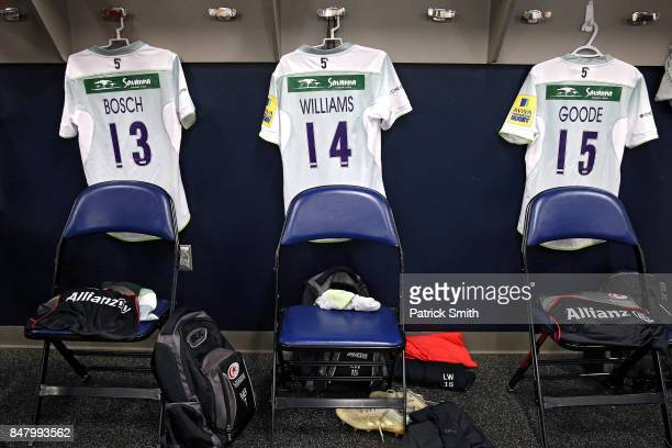 Saracens player jerseys hang in the locker room before playing against the Newcastle Falcons during a Aviva Premiership match between the Newcastle...