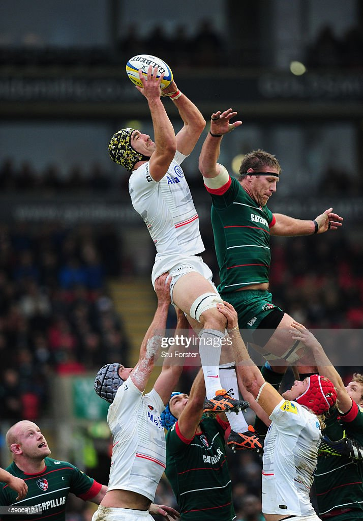 Saracens player <a gi-track='captionPersonalityLinkClicked' href=/galleries/search?phrase=Kelly+Brown+-+Rugby+Player&family=editorial&specificpeople=211000 ng-click='$event.stopPropagation()'>Kelly Brown</a> out jumps <a gi-track='captionPersonalityLinkClicked' href=/galleries/search?phrase=Brad+Thorn&family=editorial&specificpeople=224056 ng-click='$event.stopPropagation()'>Brad Thorn</a> of the Tigers during the Aviva Premiership match between Leicester Tigers and Saracens at Welford Road on November 16, 2014 in Leicester, England.
