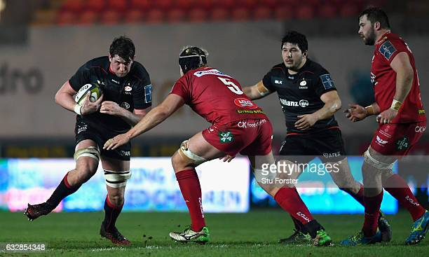 Saracens player Mark Flanagan runs with the ball into Rynier Bernardo of the Scarlets during the AngloWelsh Cup match at Parc y Scarlets on January...