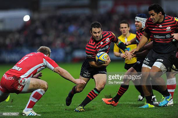 Saracens player Neil de Kock makes a break during the Aviva Premiership match between Gloucester and Saracens at Kingsholm Stadium on January 4 2014...