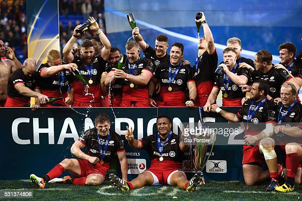 Saracens player Owen Farrell and team mates celebrate with the trophy after the European Rugby Champions Cup Final between Racing 92 and Saracens at...