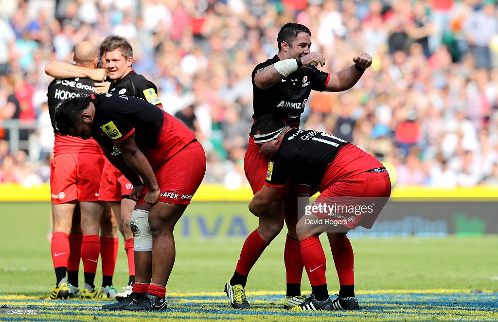 Saracens players celebrate at the final whistle of the Aviva Premiership final match between Saracens and Exeter Chiefs at Twickenham Stadium on May 28, 2016 in London, England.