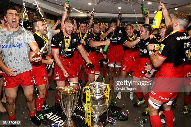 Saracens players celebrate in the dressing room after the Aviva Premiership final match between Saracens and Exeter Chiefs at Twickenham Stadium on...