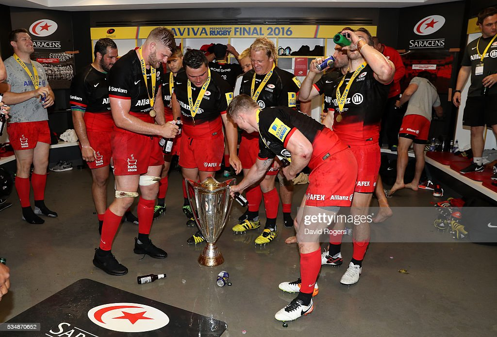 Saracens players celebrate in the dressing room after the Aviva Premiership final match between Saracens and Exeter Chiefs at Twickenham Stadium on May 28, 2016 in London, England.