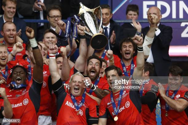 Saracens players celebrate their win with the trophy after the rugby union European Champions Cup Final match between Saracens and Clermont Auvergne...