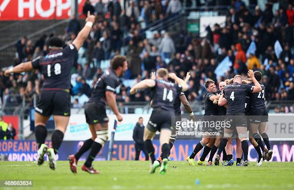 Saracens players celebrate victory after the European Rugby Champions Cup Quarter Final match between Racing Metro 92 and Saracens at Stade Yves Du...
