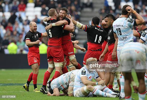 Saracens players celebrate while Racing 92 players show dejections after the European Rugby Champions Cup Final match between Racing 92 and Saracens...