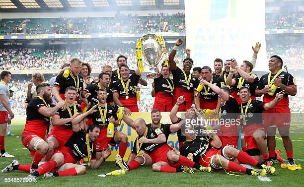 Saracens players celebrate with the trophy after the Aviva Premiership final match between Saracens and Exeter Chiefs at Twickenham Stadium on May 28...