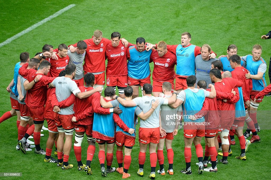 Saracens' players stand together ahead of the European Rugby Champions Cup match beetween Racing Metro 92 and Saracens FC at the Parc Olympique...
