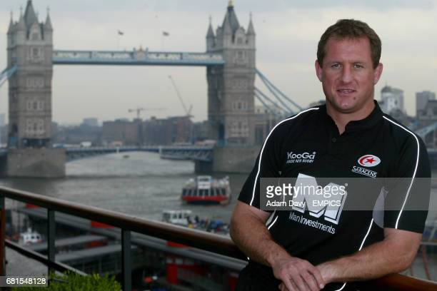Saracens' Richard Hill poses with the new shirt after the sponsors launch
