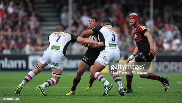 Saracens Schalk Brits is tackled by Harlequins Chris Robshaw and Kyle Sinckler during the Aviva Premiership Playoff Semi Final match at Allianz Park...