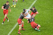 Saracens' Shaik Brits and Duncan Taylor vie for the ball during the European Rugby Champions Cup match beetween Racing Metro 92 and Saracens FC at...