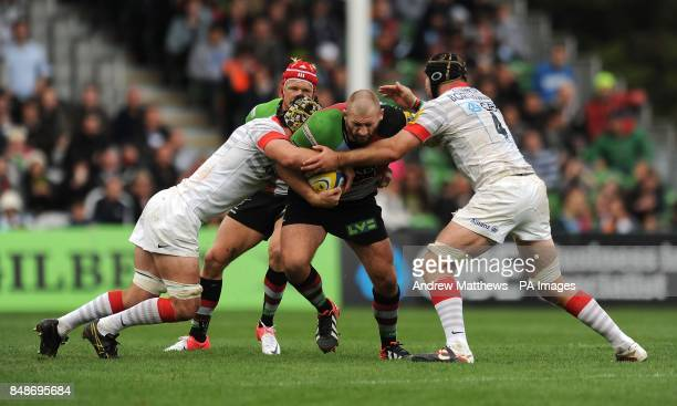 Saracens' Steve Borthwick and Kelly Brown tackle Harlequins' Joe Marler during the Aviva Premiership match at Twickenham Stoop Middlesex