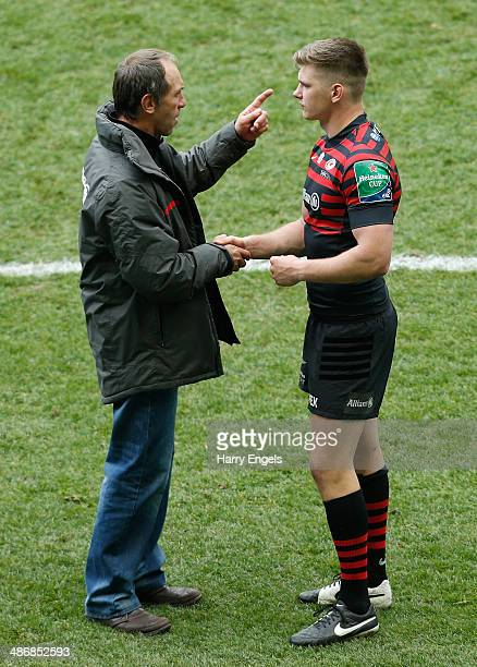 Saracens technical director Brendan Venter talks to Owen Farrell following the Heineken Cup SemiFinal match between Saracens and ASM Clermont...