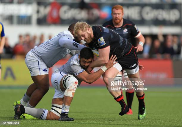 Saracens' Vincent Koch is tackled by Bath's Taulupe Faletau during the Aviva Premiership match at Allianz Park London