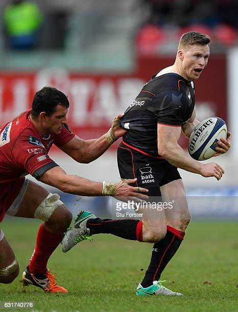 Saracens wing Chris Ashton breaks through the tackle of Aaron Shingler of the Scarlets during the European Rugby Champions Cup match between Scarlets...