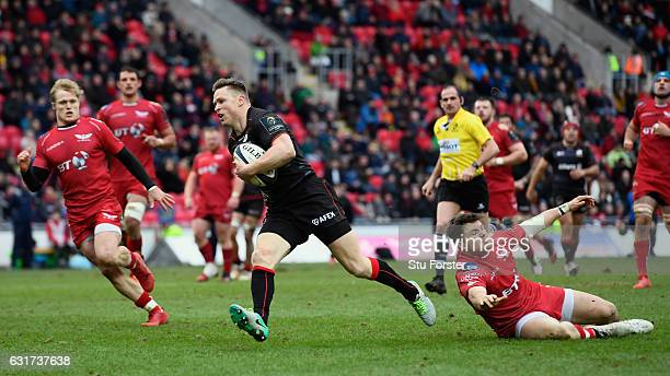 Saracens wing Chris Ashton runs in the second Saracens try during the European Rugby Champions Cup match between Scarlets and Sarcens at Parc y...