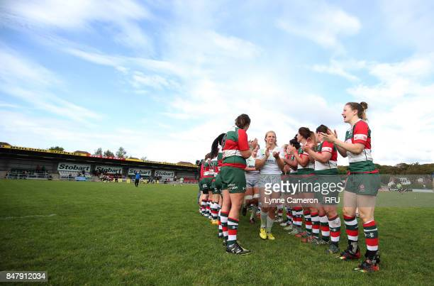 Saracens Women are applauded off the pitch by Firwood Waterloo Ladies after winning the Tyrrells Premier 15 at The Memorial Ground on September 16...