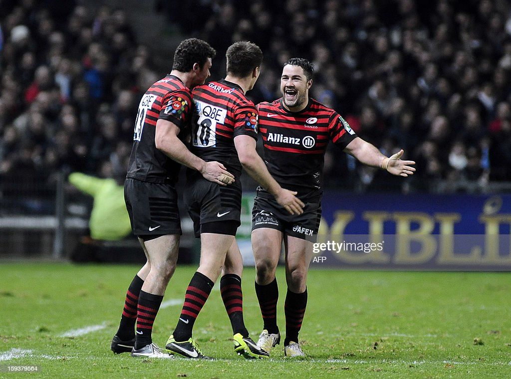 Saracens's (L to R) Duncan Taylor, Owen Farrel and Brad Barrit celebrate at the end of the European Cup rugby union match between Racing Metro and Saracens on January 12, 2013, at the Beaujoire Stadium in Nantes, western France.
