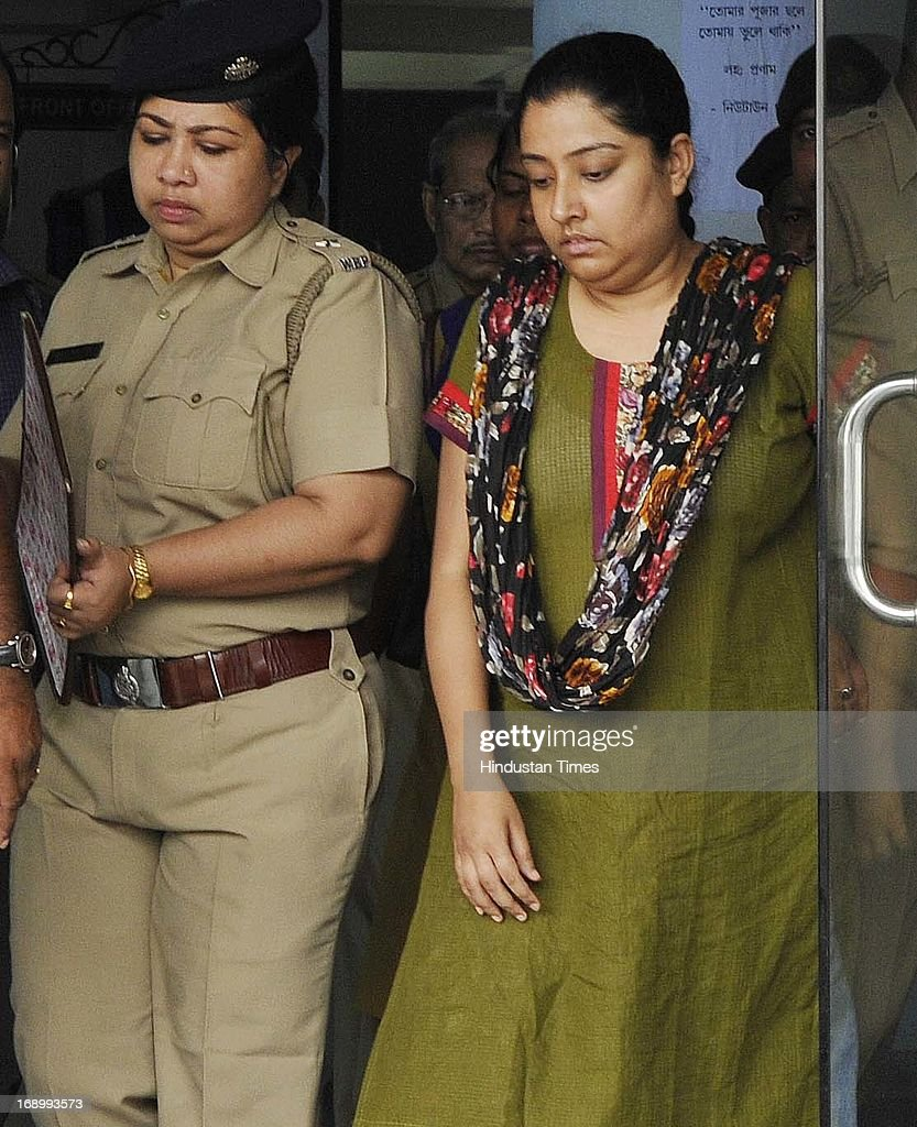 Saradha Chief Sudipta Sen's alleged accomplice Debjani Mukherjee comes out from Rajarhat New Town Police station before she was produced in the Salt Lake Court on May 18, 2013 in Kolkata, India. Saradha Chief Sudipta Sen along with Saradha Director Debjani Mukherjee and Arvind Singh Chouhan were sent to nine days police custody in fresh case. Thousands of investors allegedly lost over INR 200-300 billion when group collapsed in April 2013.