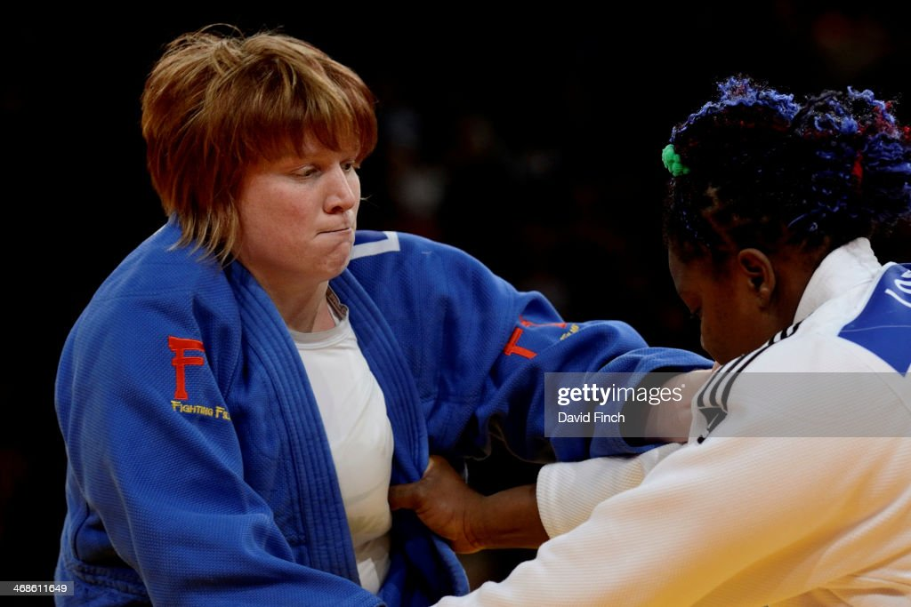 Sarah Adlington of Great Britain (blue) narrowly defeated London Olympic champion, <a gi-track='captionPersonalityLinkClicked' href=/galleries/search?phrase=Idalys+Ortiz&family=editorial&specificpeople=5492242 ng-click='$event.stopPropagation()'>Idalys Ortiz</a> of Cuba, to reach the o78kg semi-final during the Paris Grand Slam on Sunday, February 09, 2014 at the Palais Omnisports de Paris, Bercy, Paris, France.