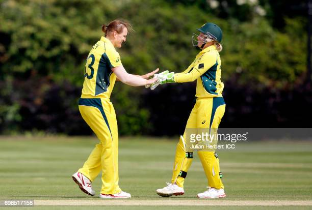 Sarah Aley and Alyssa Healy of Australia celebrate the wicket of Chloe Tryon of South Africa during the ICC Women's World Cup warm up match between...