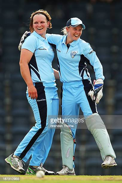 Sarah Aley of NSW celebrates with team mate Alyssa Healy after running out Kelly Applebee of Victoria during the WT20 match between New South Wales...