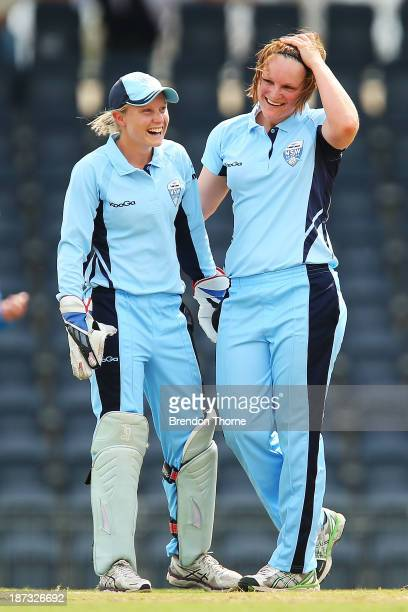 Sarah Aley of NSW celebrates with team mate Alyssa Healy after claiming the wicket of Sarah Elliot of Victoria during the WT20 match between New...