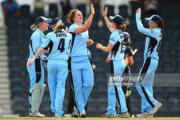 Sarah Aley of NSW celebrates with team mates after claiming the wicket of Sarah Elliot of Victoria during the WT20 match between New South Wales and...