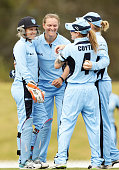 Sarah Aley of the Breakers celebrates with team mates after taking the wicket of Rene Farrell of the Meteors during the WT20 match between New South...