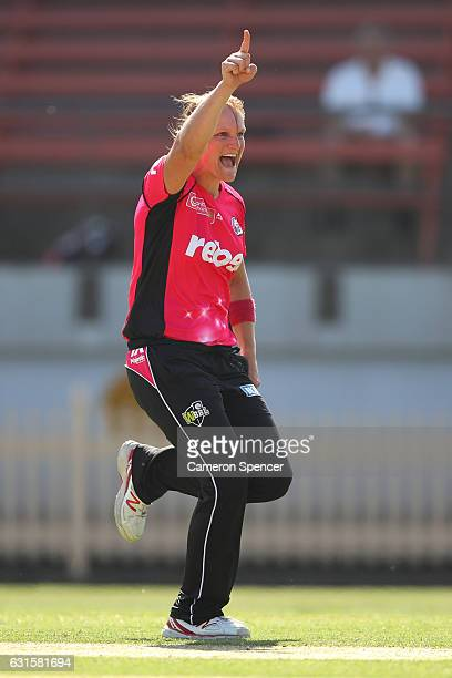 Sarah Aley of the Sixers celebrates dismissing Amy Satterthwaite of the Hurricanes during the Women's Big Bash League match between the Hobart...