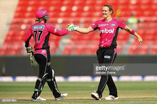 Sarah Aley of the Sixers celebrates with team mate Alyssa Healy after claiming the wicket of Rachael Haynes of the Thunder during the WBBL match...