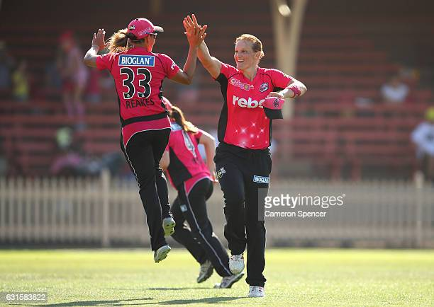Sarah Aley of the Sixers celebrates with team mate Angela Reakes after dismissing Emma Thompson of the Hurricanes during the Women's Big Bash League...