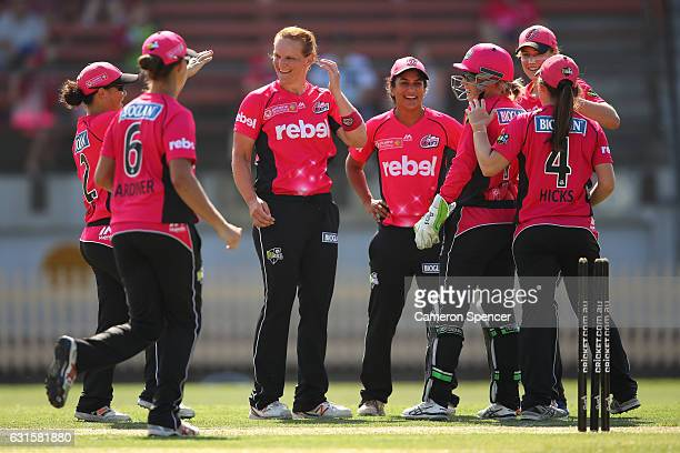 Sarah Aley of the Sixers celebrates with team mates after dismissing Amy Satterthwaite of the Hurricanes during the Women's Big Bash League match...