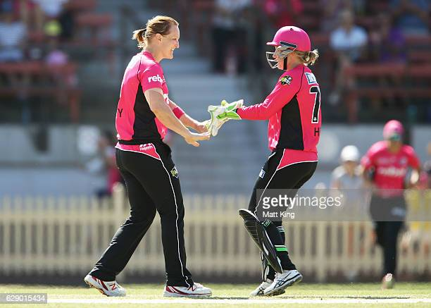 Sarah Aley of the Sixers celebrates with team mates after taking the wicket of Kirby Short of the Heat during the Women's Big Bash League match...