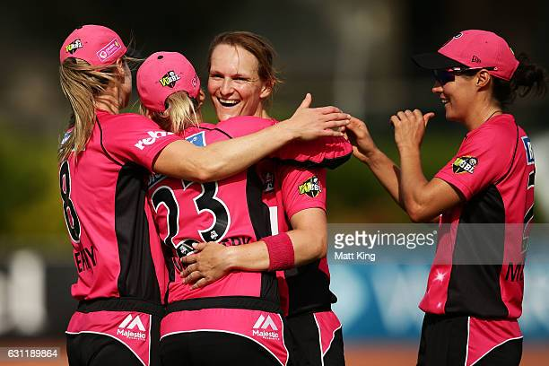 Sarah Aley of the Sixers celebrates with team mates after taking the wicket of Suzie Bates of the Scorchers during the Women's Big Bash League match...