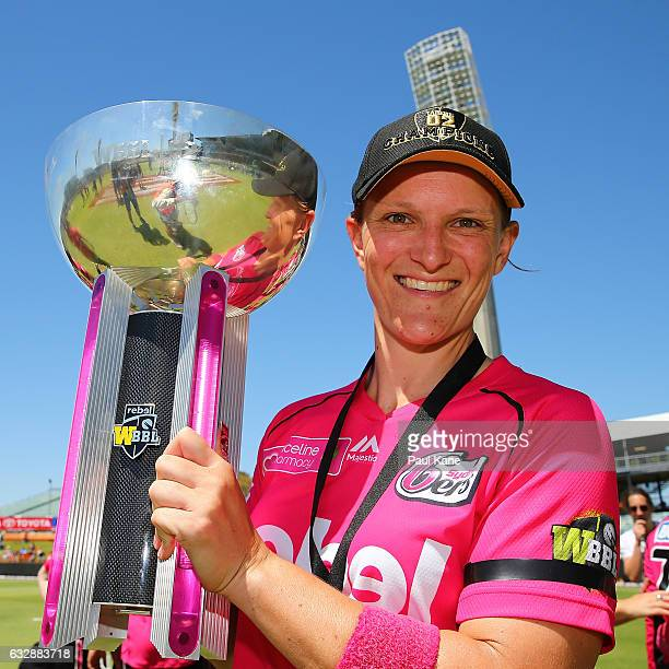 Sarah Aley of the Sixers holds the trophy after winning the Women's Big Bash League match between the Perth Scorchers and the Sydney Sixers at WACA...