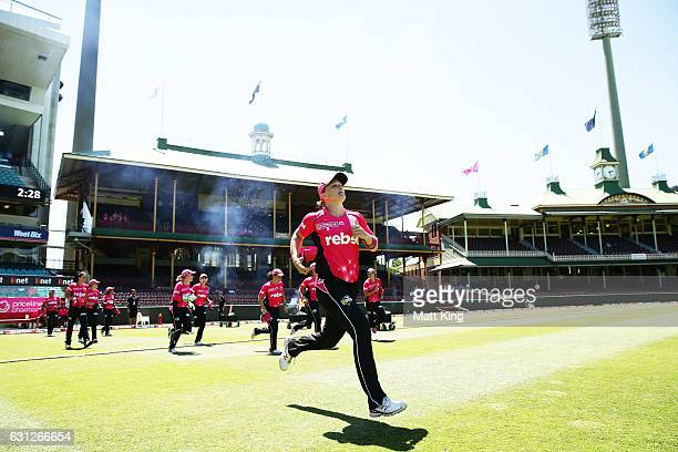 Sarah Aley of the Sixers runs onto the field during the Women's Big Bash League match between the Sydney Sixers and the Perth Scorchers at Sydney...